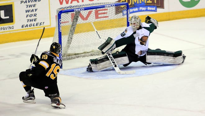 Colorado's Luke Salazar fires a shot past Utah Grizzlies goalie Ryan Faragher for a goal in a March 25 game at the Budweiser Events Center. The Eagles will open the ECHL playoffs at home April 14-15 against the Idaho Steelheads.