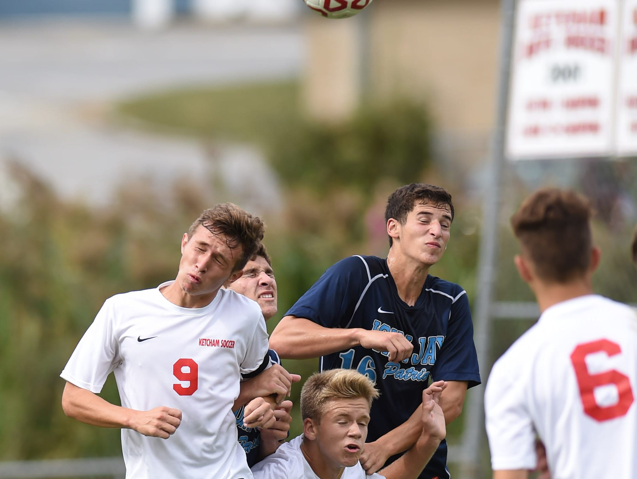 From left, Roy C. Ketcham's Nick Boscheller, Dylan Ramage and John Jay's Nicholas Gardner challenge each other for a header during Saturday's game at Ketcham.