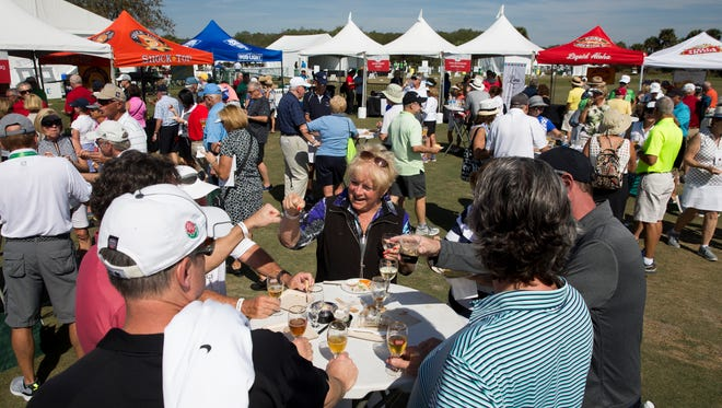 "Spectators enjoy themselves to food and beverages inside of the ""Taste of Southwest Florida"" dining area during the first round of the Chubb Classic at TwinEagles Club Friday, Feb. 17, 2017 in Naples. The event highlighted local restaurants, breweries, and other products from the area."