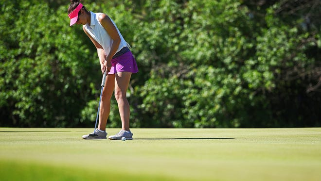 Parkston's Jayden Bormann putts on the third hole of Central Valley Golf Club during the South Dakota Class A State Girls Golf Tournament Monday, June 5, 2017, in Hartford, S.D.