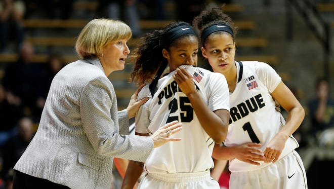 Purdue coach Sharon Versyp with instructions for April Wilson, center, and Ashley Morrissette during a Purdue free throw attempt against Rutgers at  Mackey Arena. Purdue defeated Rutgers 74-68 in overtime last week.