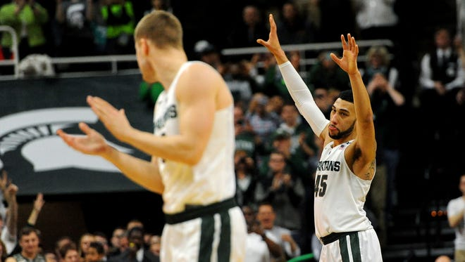 MSU guard Denzel Valentine waves to the crowd as he leaves the court near the end of the Spartans' 91-76 victory over Ohio State Saturday. He finished with 27 points and 13 assists in his final game at Breslin Center.