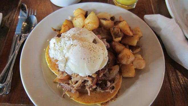 The Southern Stack is pulled pork over sweet potato pancakes with fried apples, topped with an egg.