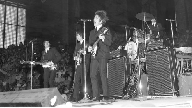 The Beatles performing at the Indiana State Fairgrounds Coliseum on Sept. 3 1964.