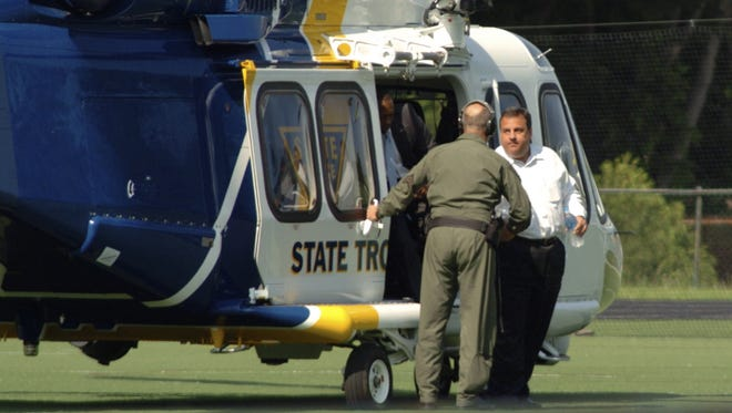 In this May 31 photo, Gov. Chris Christie (right) exits a state helicopter to attend his son's high school baseball game in Montvale.