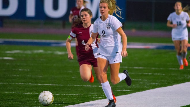 St. Thomas More's Mattie Marks (2), shown here sprinting to the ball during the semifinals win over Destrehan, is hoping to lead the Lady Cougars to their first state soccer state championship since 2008.