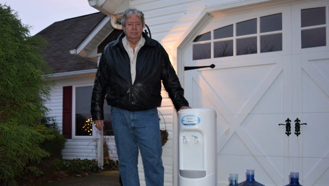 Robert Phillips, 70, is one of many Millsboro-area residents who opened their doors to a surprise water delivery this week. The water, provided on behalf of Mountaire Farms, came with no instructions and no explanation.
