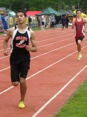 Omar Kaddurah of Grand Blanc runs 4:07.59, at the time