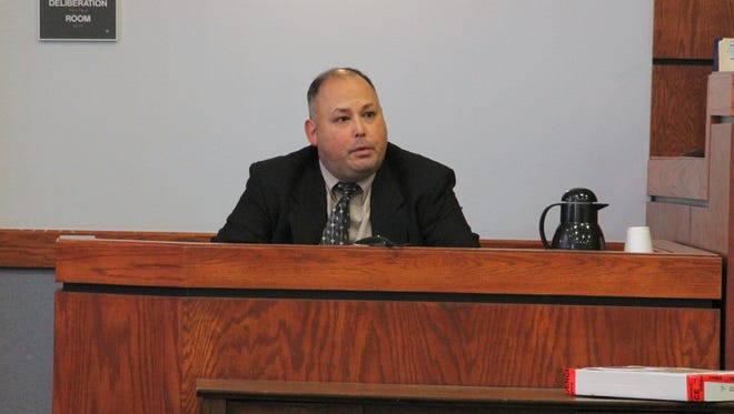 Former Alamogordo Police officer Warren D. Whittington testified during his assault trial in 12th Judicial District Court Thursday. He was found guilty.