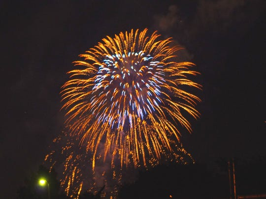 Fireworks from Redding's Freedom Festival light up the night sky Tuesday.