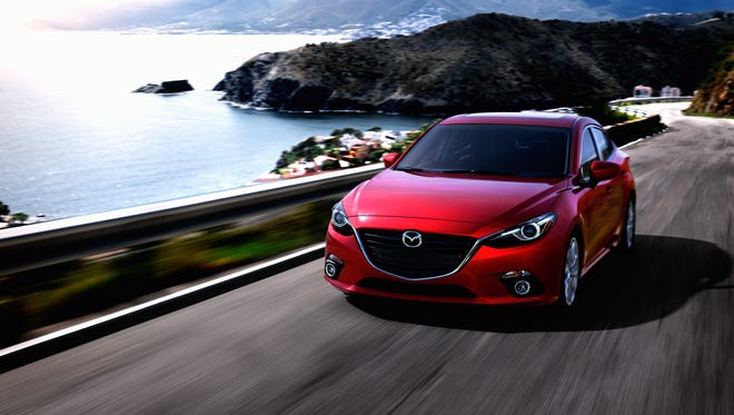A fast roofline and high decklid give the 2014 Mazda3 a speedy stance, accented by 16-inch alloys.