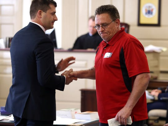 Assistant Prosecutor Matthew Troiano shakes hands with Paul Gilhuley after he gave a victim impact statement  in Morris County Superior Court. Virginia Vertetis was sentenced to 30 years, found guilty of murder in April after prosecutors argued that she purposely shot her ex-boyfriend, Patrick Gilhuley at her Mount Olive home in 2014 out of desperation that he was breaking up with her. May 23, 2017, Morristown, NJ.