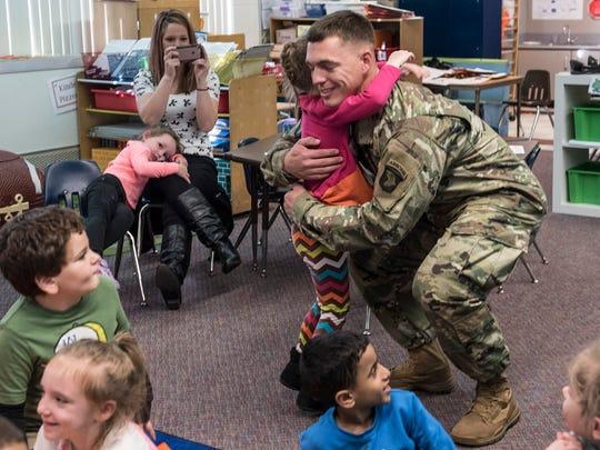 Kaylee Diehl greets her dad, Sgt. Michael Diehl, just
