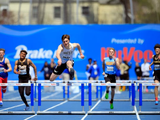 Austin West of Iowa City West wins the boys 400 meter hurdles relay at the Drake Relays Saturday, April 28, 2018.