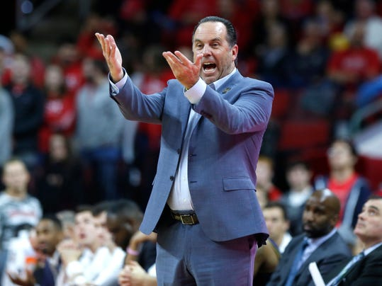 Notre Dame's head coach Mike Brey yells to the officials during the second half of an NCAA college basketball game against North Carolina State at PNC Arena in Raleigh, N.C., Saturday, Feb. 3, 2018. (Ethan Hyman/The News & Observer via AP)