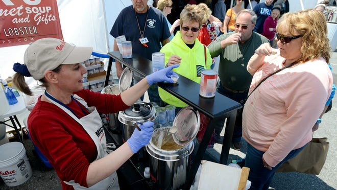 Lauren Pinder, left, pours samples of fresh soup at the Mick's Gourmet Soups & Gifts tent at a previous Springfest.