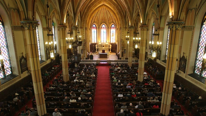 The congregation attends mass at Assumption Church on the last day of masses before it closes, Sunday, Nov. 2, 2014.