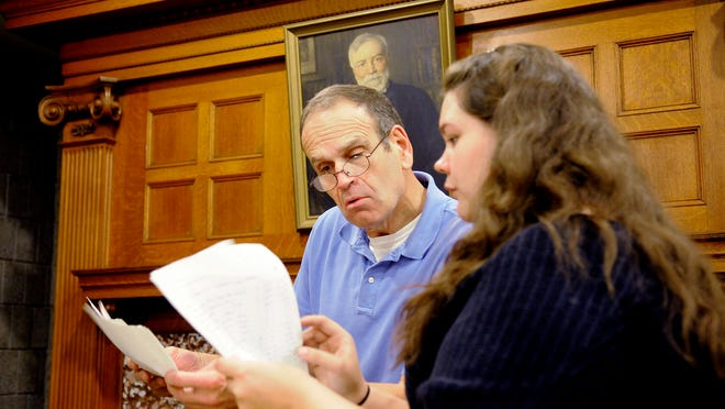 Stearns History Museum Director of Archives John Decker and intern Jesica Kula look through materials donated to the museum Tuesday.