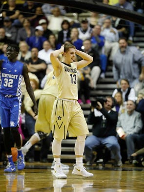 Vanderbilt guard Riley LaChance (13) reacts during