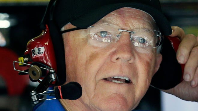 In this Nov. 5, 2016, file photo, team owner Joe Gibbs listens in the garage during NASCAR auto racing practice at Texas Motor Speedway in Fort Worth, Texas.