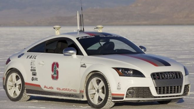 With a new report showing driverless cars will big sellers in the next decade, automakers are racing to develop them. Audi created a driverless car to race up Pikes Peak.