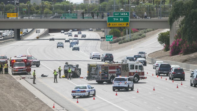 A rollover crash on Interstate 10 Sunday afternoon killed two, injured seven and closed the westbound lanes of the freeway at State Route 51