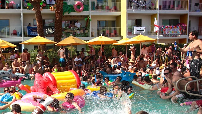 Guests attend the first weekend of a pool party music festival, Splash House, at three separate venues in Palm Springs on Saturday.