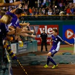Louisville City FC's Magnus Rasmussen gets ready to leap into the crowd of fans after scoring a goal. Aug. 22, 2015