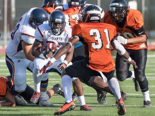 College of the Sequoias Isaiah Hilliard runs against Reedley College in a scrimmage on Tuesday, August 21, 2018.