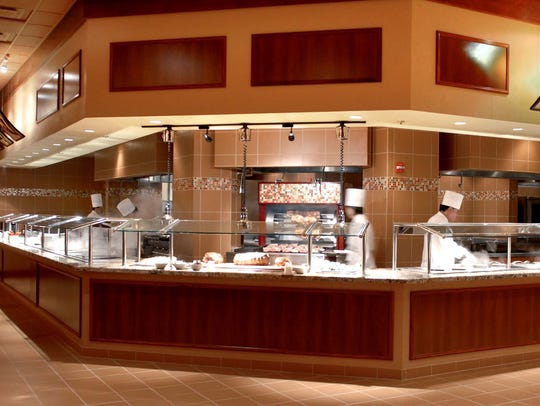 The rotisserie and carving station at the buffet in