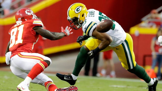 Green Bay Packers safety Marwin Evans (25) breaks up a pass intended for Kansas City Chiefs wide receiver Tyreek Hill.