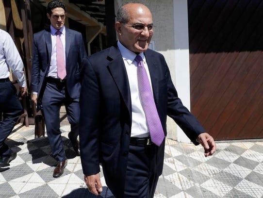 Church leader Juarez de Souza Oliveira, right, linked