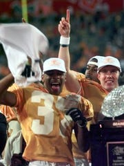 Tennessee's Peerless Price (37) celebrates with teammates after beating Florida State 23-16 to win the first BCS national title on Jan. 4, 1999.