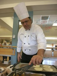 Dave Sunken, chef at The Village, makes zucchini pancakes.