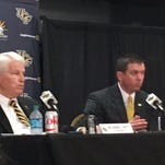 UCF's new director of athletics Danny White, right, spekas with UCF President John C. Hitt during his first press conference at the university Nov. 19.
