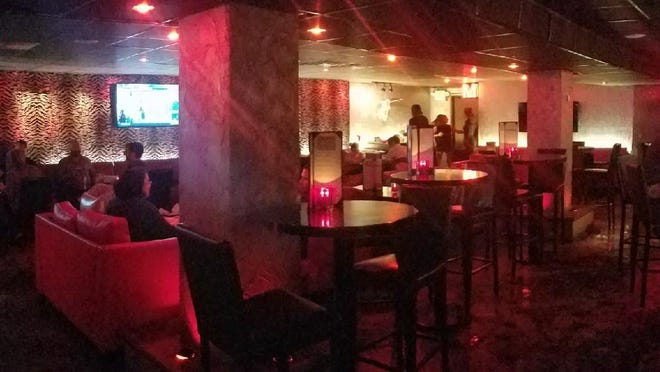 The Red Room downstairs at Flame lives up to its colorful name.