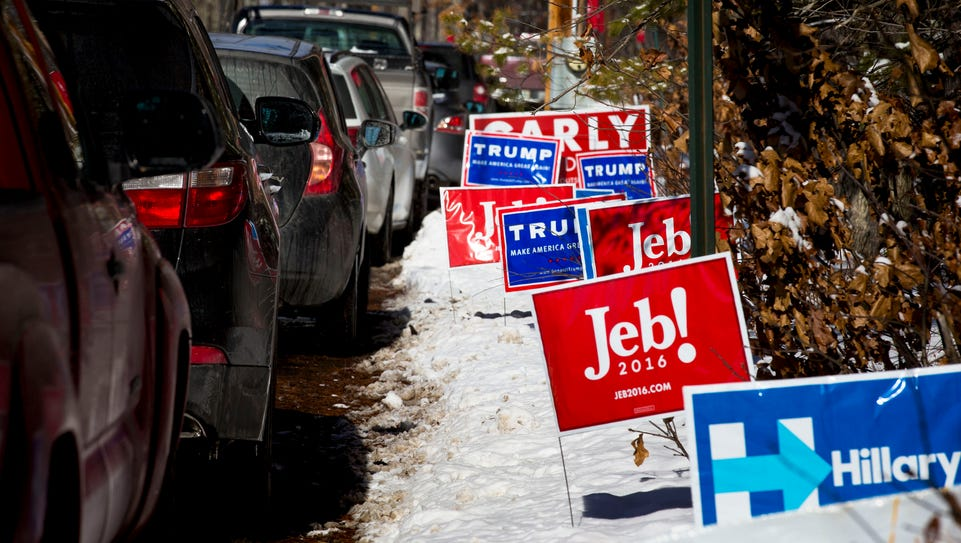 Candidate signs line the street outside the Nashua