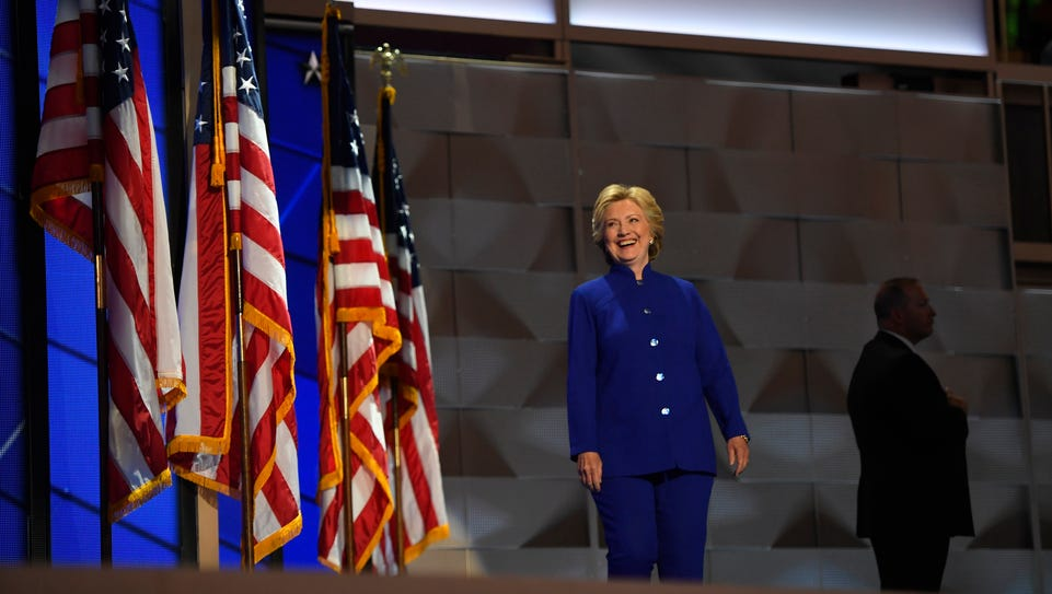 Hillary Clinton enters the stage to meet President