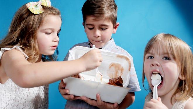 (Left to right) Adaley Jamison, Samuel Jamison and June Jamison enjoy eating frozen yogurt sundae from Counter Culture.