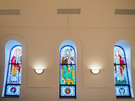 A stained-glass window inside St. George Greek Orthodox Church on Wednesday, March 28, 2018. The windows were recently installed at the church, which is being restored after nearly being destroyed in a fire three years ago.