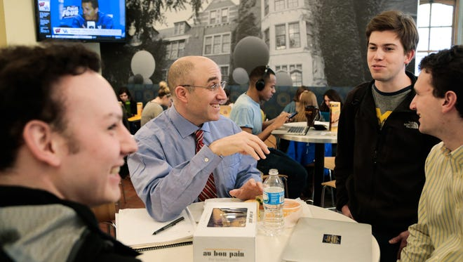 University of Michigan Regent Mark Bernstein talks with University of Michigan students Ian Savas (left), graduate student Michael Proppe and student body president Bobby Dishell during open office hours at the Michigan Union on the University of Michigan campus in Ann Arbor on Thursday April 2, 2015 while allowing students to discuss university related issues with him.