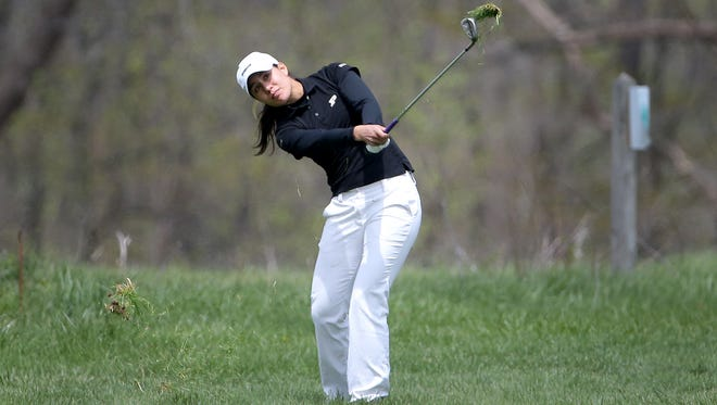 Purdue's Aurora Kan hit her approach shot on the 6th hole during the first round of the Big Ten women's golf tourney Friday, April 24, 2015, at The Fort Golf Course in Indianapolis.