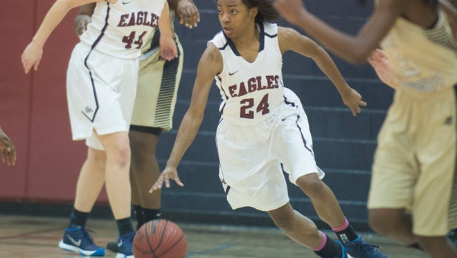 Montgomery Academy's Jade Brooks (24) dribbles up the court during the playoff game between Montgomery Academy and Hale County on Monday, Feb. 15, 2016, in Montgomery, Ala.