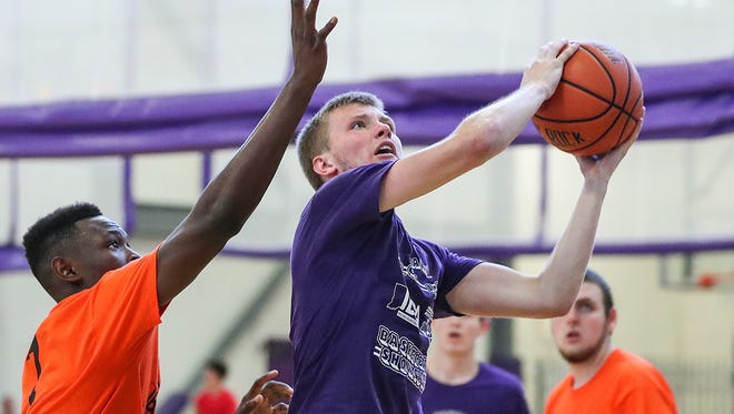 Bedford North Lawrence junior Brayton Bailey breaks past a defender toward the basket during the 16th annual IBCA/IHSAA Underclass Boys Showcase at Ben Davis High School in Indianapolis, Monday, July 9, 2018.