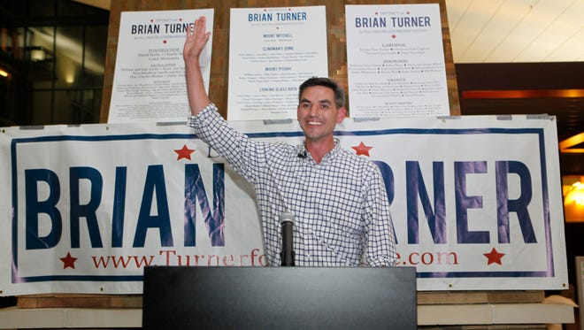 Brian Turner celebrates his win in the N.C. House race against incumbent Tim Moffitt Tuesday night.