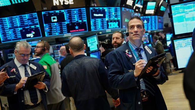 NEW YORK, NY - APRIL 4: Traders and financial professionals work on the floor of the New York Stock Exchange (NYSE) ahead of the opening bell, April 4, 2018 in New York City. The Dow dropped over 300 points on Wednesday morning after China announced new tariffs on 106 U.S. products. (Photo by Drew Angerer/Getty Images)