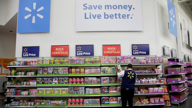 A Walmart employee scans items while conducting an exercise during a Walmart Academy class session at the store in North Bergen, N.J. Walmart is offering its employees a new perk: affordable access to a college degree. America's largest private employer, which in the past has helped its workers get their high school or equivalency degree, hopes the new benefit will help it recruit and retain higher quality entry-level employees in a tight U.S. labor market.