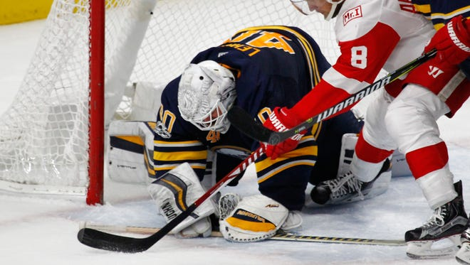 Sabres goalie Robin Lehner stops Red Wings forward Justin Abdelkader during the third period of the Wings' 1-0 loss on Tuesday Oct. 24, 2017, in Buffalo, N.Y.