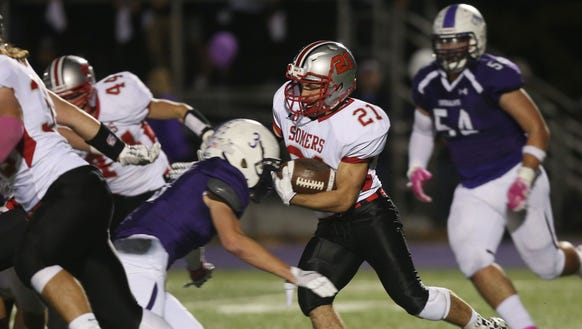 Somers' Michael Somoza (21) looks for some running
