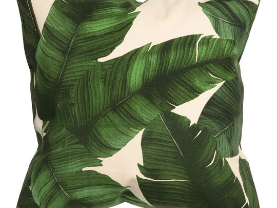 In this photo provided by H&M, a vintage style palm leaf print graces a chic throw pillow from H&M Home.